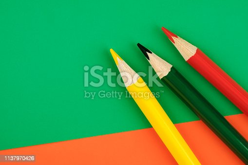 1137970382 istock photo Colored pencils color papers geometry flat composition background 1137970426