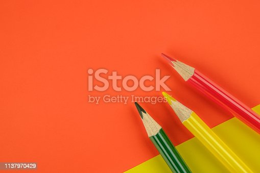 1137970382 istock photo Colored pencils color papers geometry flat composition background 1137970429