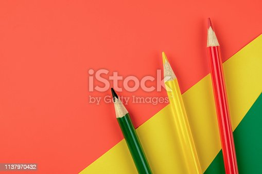 1137970382 istock photo Colored pencils color papers geometry flat composition background 1137970432