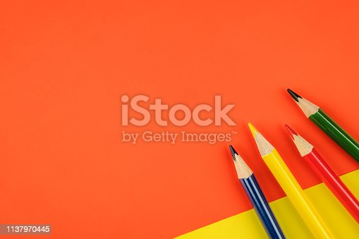 1137970382 istock photo Colored pencils color papers geometry flat composition background 1137970445