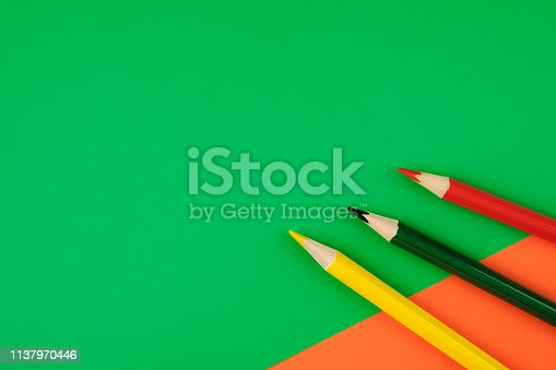 1137970382 istock photo Colored pencils color papers geometry flat composition background 1137970446