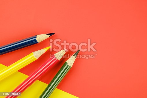 1137970382 istock photo Colored pencils color papers geometry flat composition background 1137970447