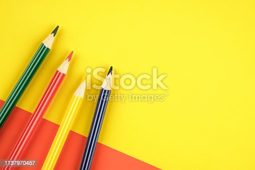 1137970382 istock photo Colored pencils color papers geometry flat composition background 1137970457