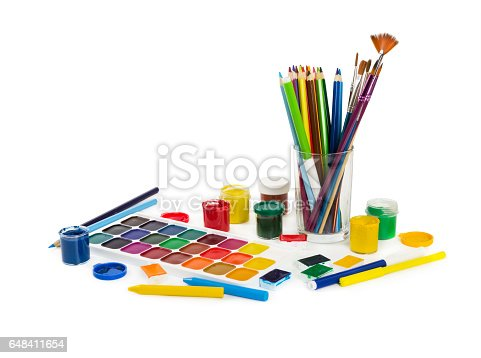 123499844 istock photo Colored pencils, felt tip pens, chalks, brushes and paint for painting 648411654