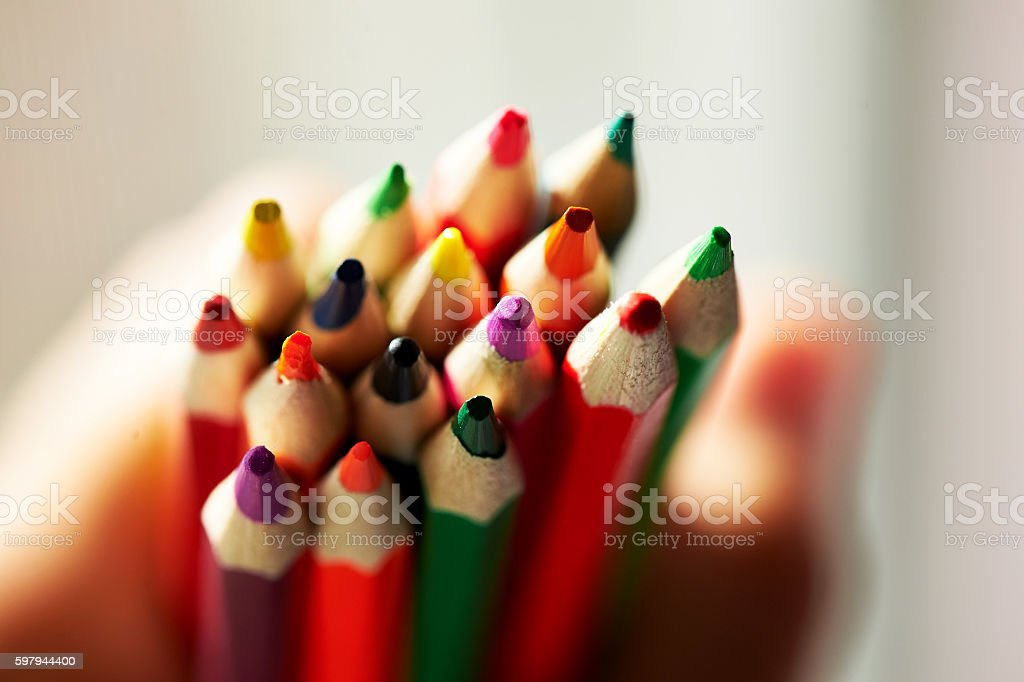 Colored pencils in children's hands, sharpened foto royalty-free