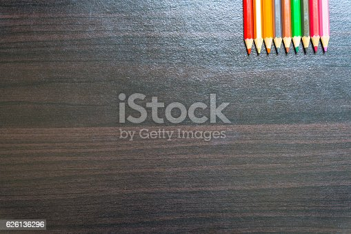 639376084 istock photo Colored pencils on a wooden board 626136296