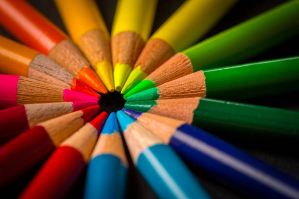 Colored pencils on black background stock photo