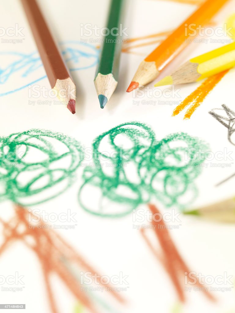 Colored Pencils On Child's Drawing royalty-free stock photo
