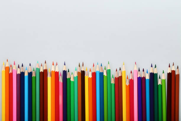 colored pencils on gray background - pencil stock pictures, royalty-free photos & images