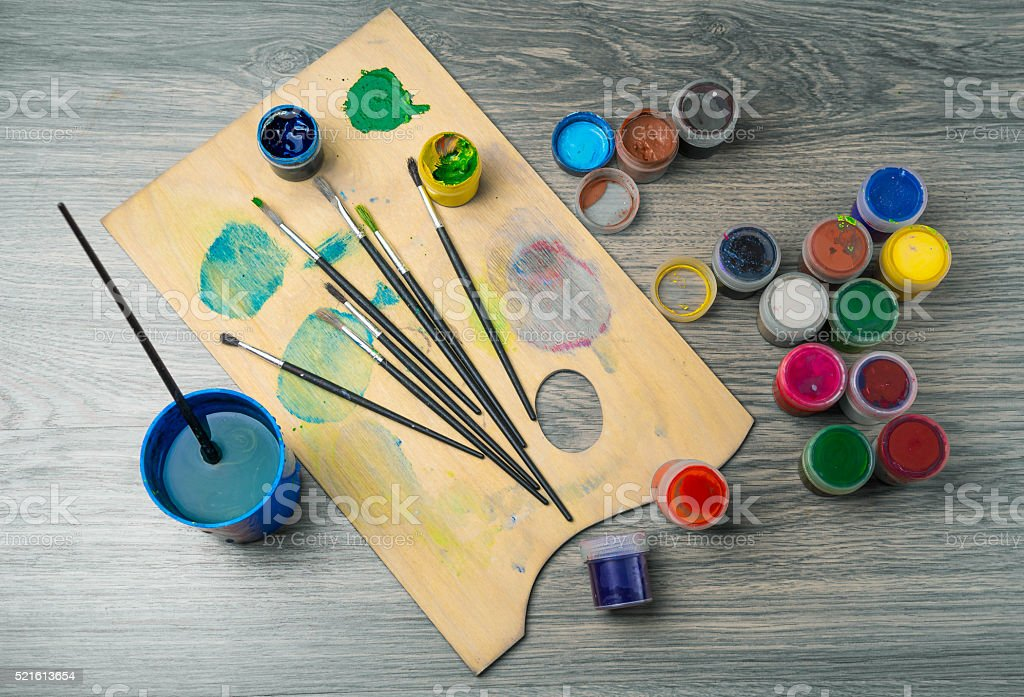colored pencils paint brush against  dark table stock photo