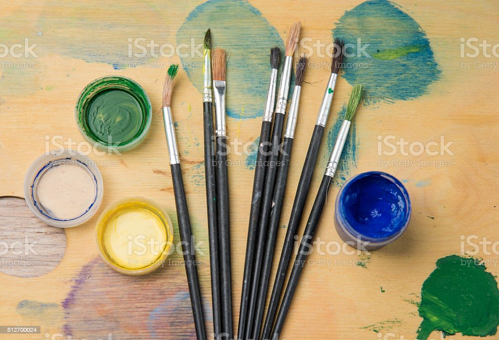 colored pencils paint brush against the dark stock photo