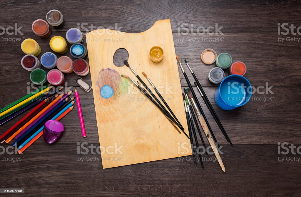 colored pencils paint brush on the dark table stock photo
