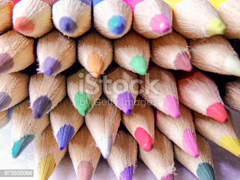 A handful of colored pencils waiting to be used