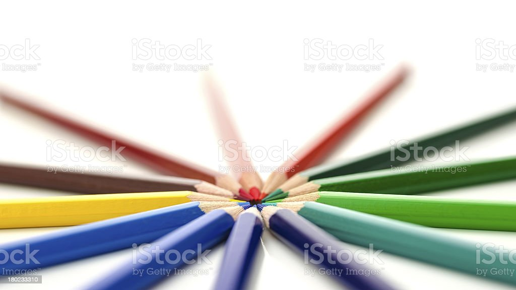 Colored pencils pointing in circle royalty-free stock photo