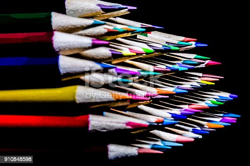 Colored pencils stacked neatly and ready for use in a classroom or an art studio.  Graphic Design tools