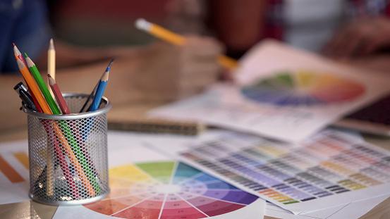 istock Colored pencils standing in metal holder, designers looking at color spectrum 1135490344