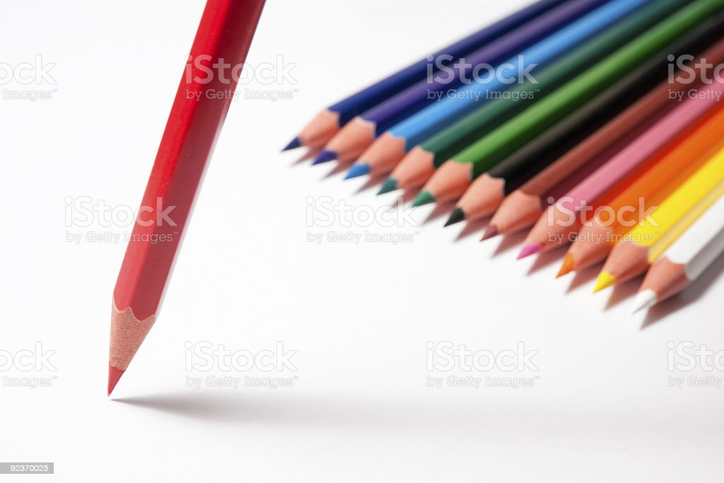 Colored pencils with red one in front. High angle. royalty-free stock photo