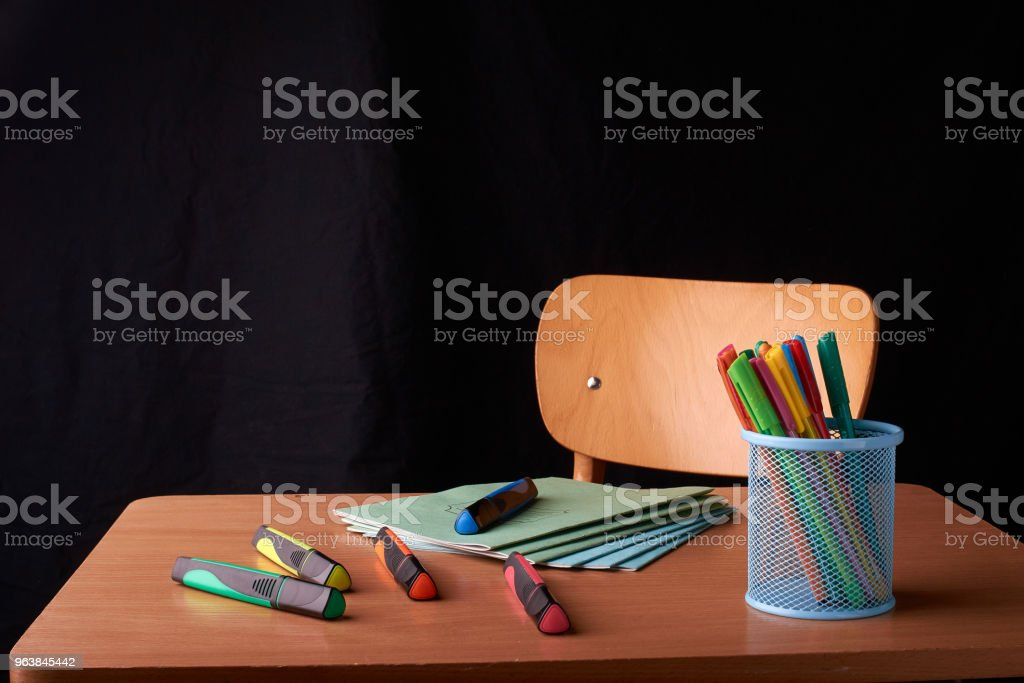 Colored Pens in a blue metal basket on desk in school - Royalty-free Art Stock Photo
