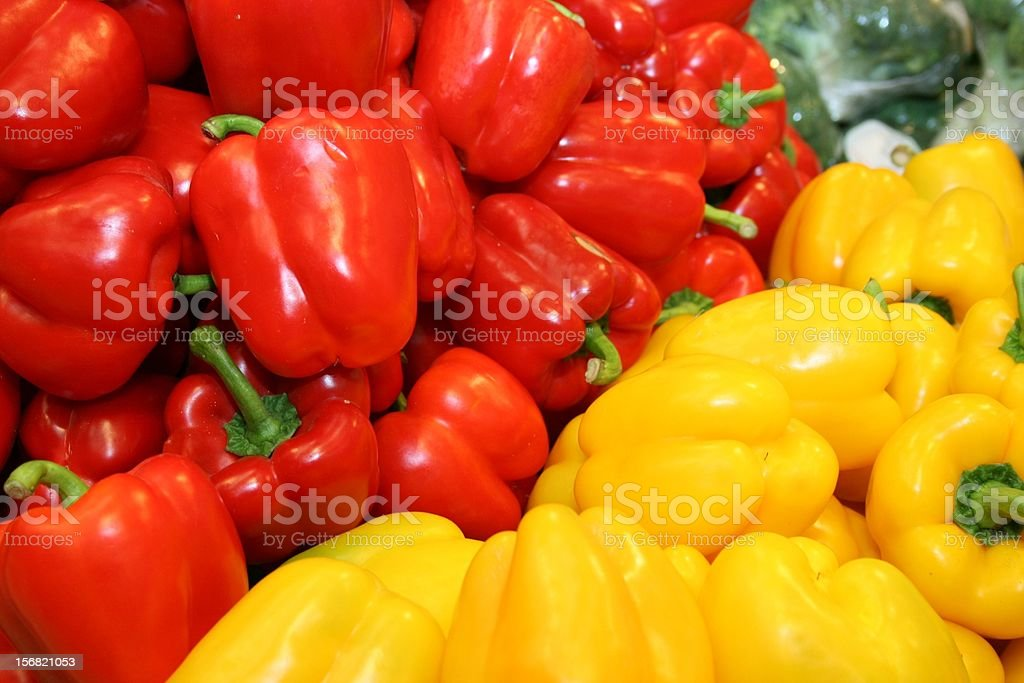 Colored peppers for sale in supermarket royalty-free stock photo