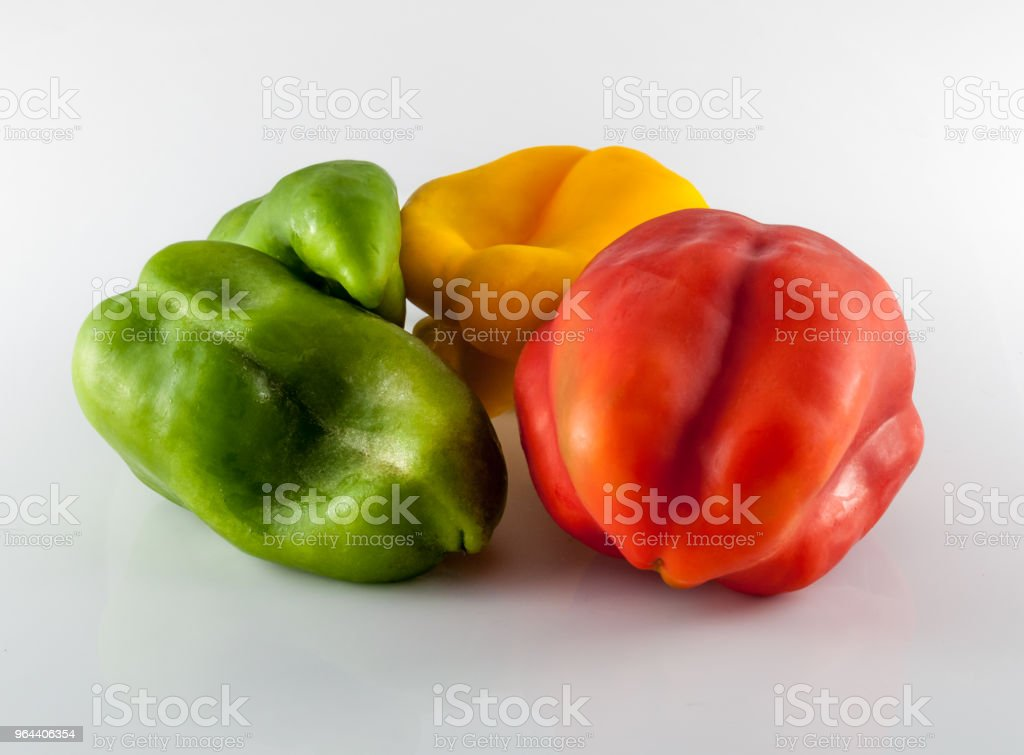 colored peppers on white background - Royalty-free Bell Pepper Stock Photo