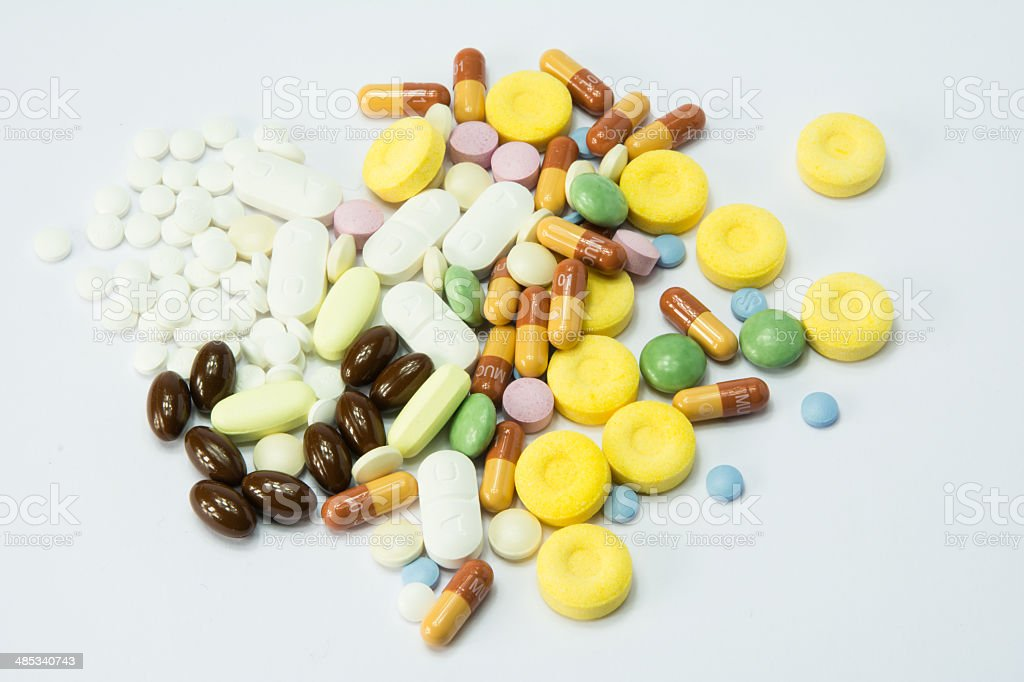 colored pills over white baackground royalty-free stock photo