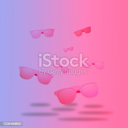 1125575680 istock photo colored pink sunglasses float in the air. 1026469832