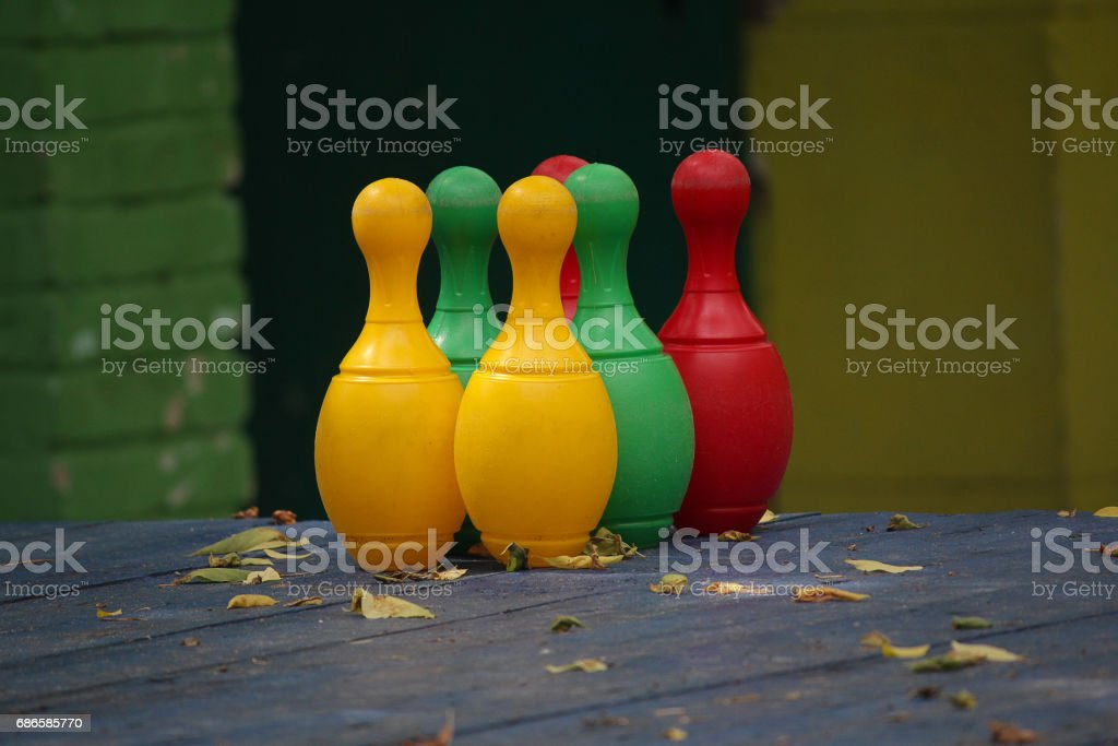 Colored pins on a wooden floor. Game royalty-free stock photo