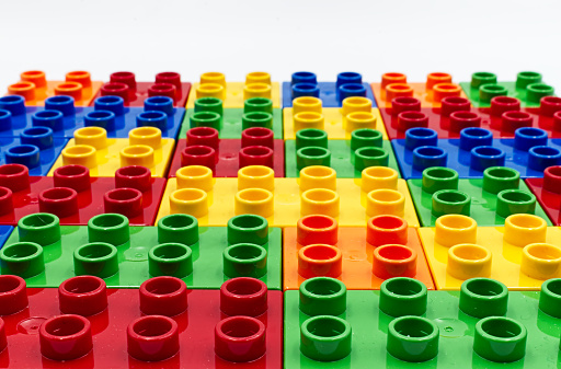 Colored plastic building blocks isolated on white
