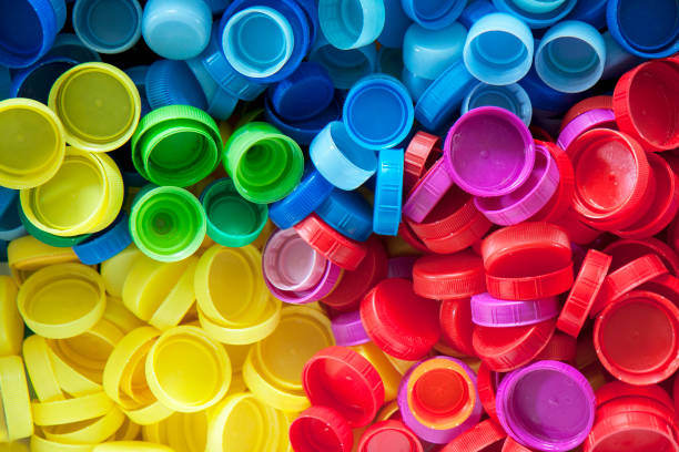 colored plastic caps. - plastic stock pictures, royalty-free photos & images