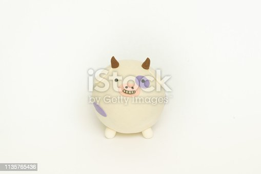 624869600 istock photo Colored plasticine cow 1135765436