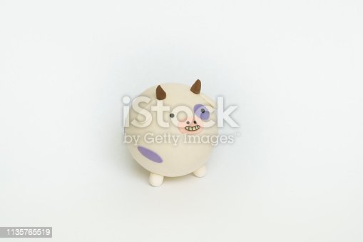 624869600 istock photo Colored plasticine cow 1135765519