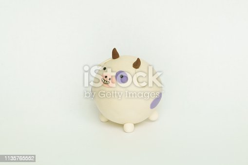 624869600 istock photo Colored plasticine cow 1135765552