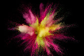 istock Colored powder explosion. Abstract closeup dust on backdrop. Colorful explode. Paint holi 1072094112
