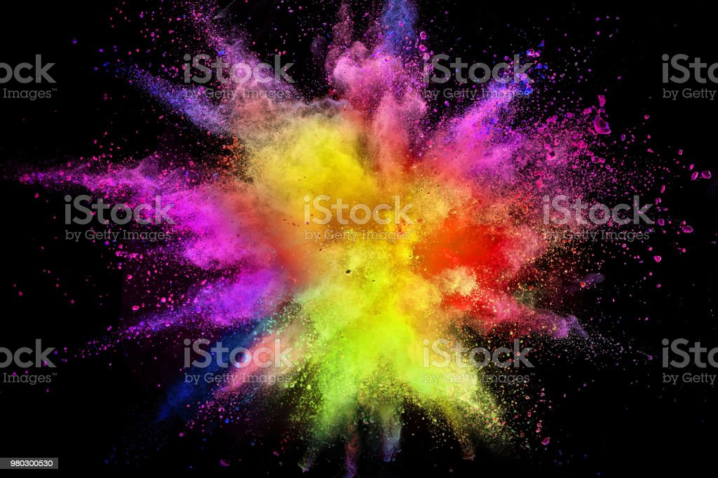 Colored powder explosion isolated on black background. Freeze motion.