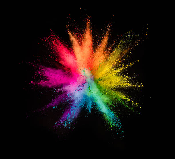 colored powder explosion on black background - colore descrittivo foto e immagini stock