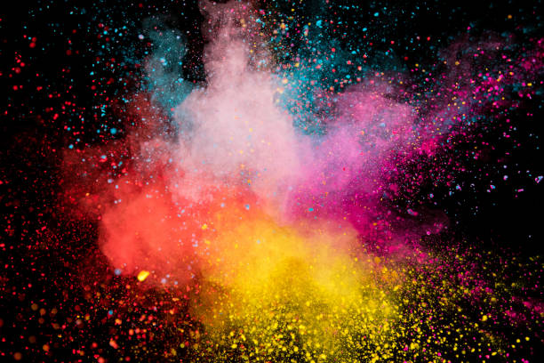 Colored powder explosion on black background. stock photo