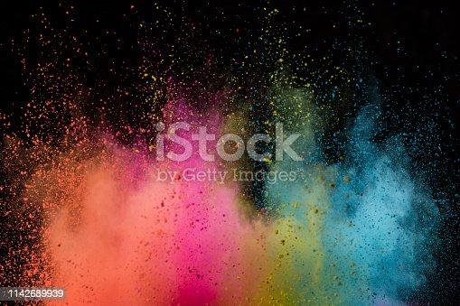 857348256istockphoto Colored powder explosion on black background. 1142689939