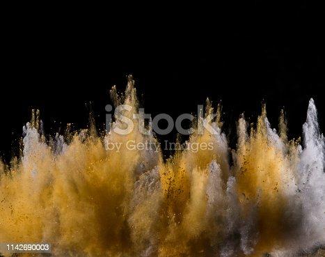 857348256istockphoto Colored powder explosion on black background. 1142690003