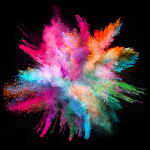 Colored powder explosion on black background stock photo
