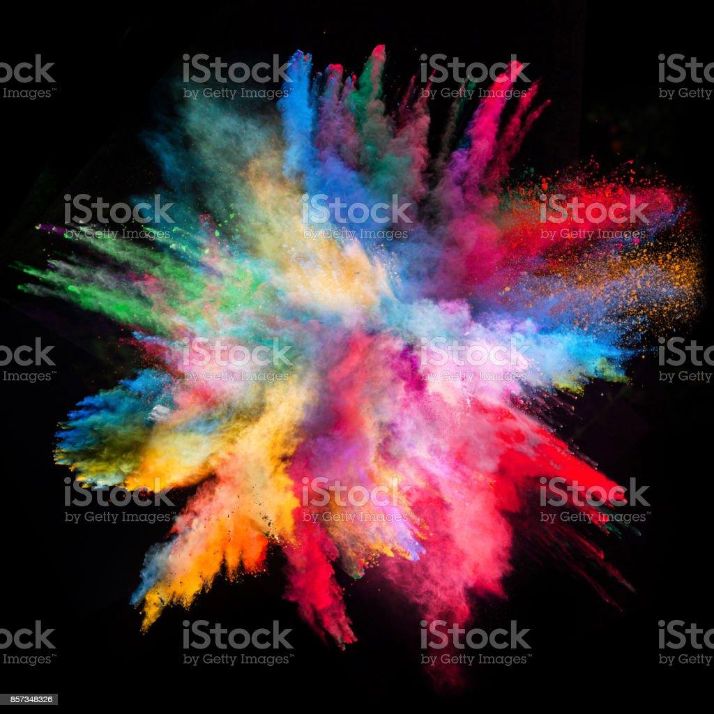 黒の背景に色付きの粉塵爆発 ストックフォト
