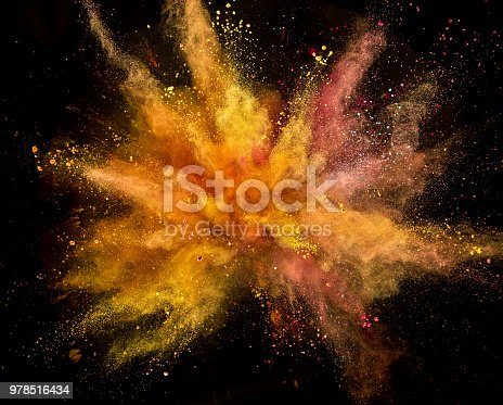 857348256istockphoto Colored powder explosion on black background 978516434