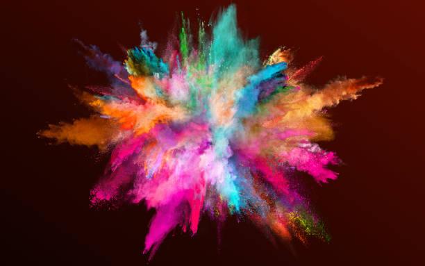 Colored powder explosion on gradient dark background. stock photo