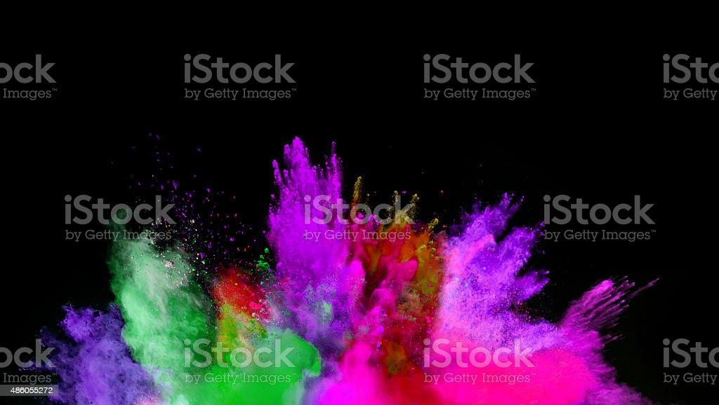 色とりどりの粉に黒色の背景 ストックフォト