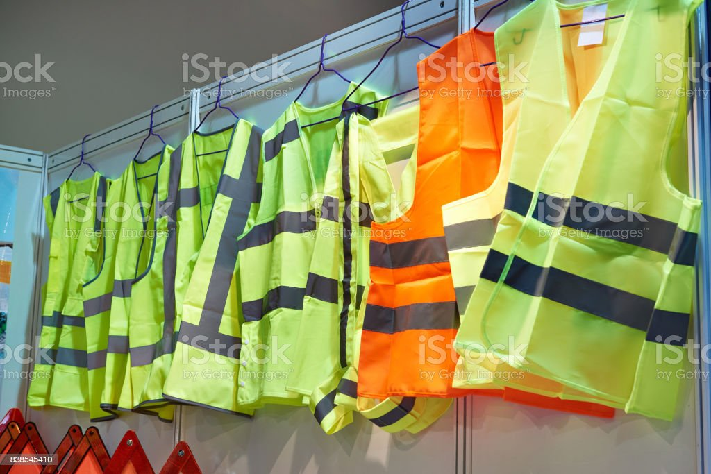 Colored, reflective vests for drivers and road workers stock photo