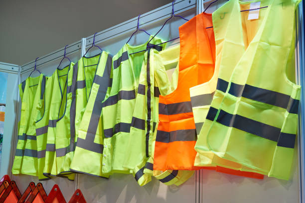 Colored, reflective vests for drivers and road workers Colored, reflective vests for drivers and road workers reflective clothing stock pictures, royalty-free photos & images