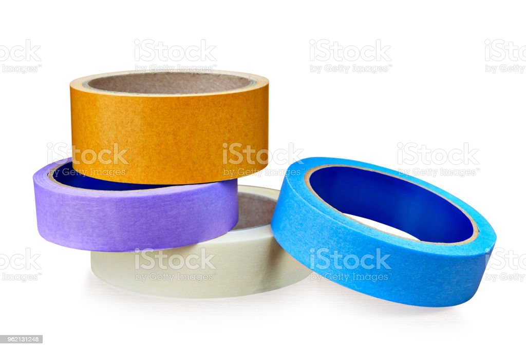 Colored rolls of  paper and plastic  duct tape on white. stock photo