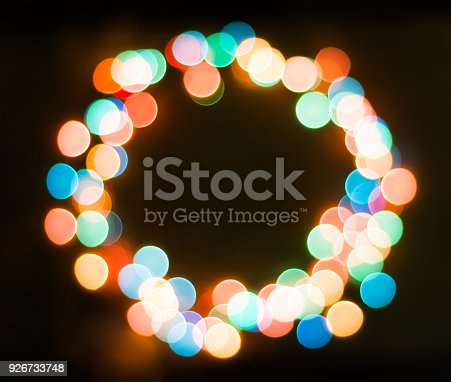 Colored rounded bokeh on dark background, ring