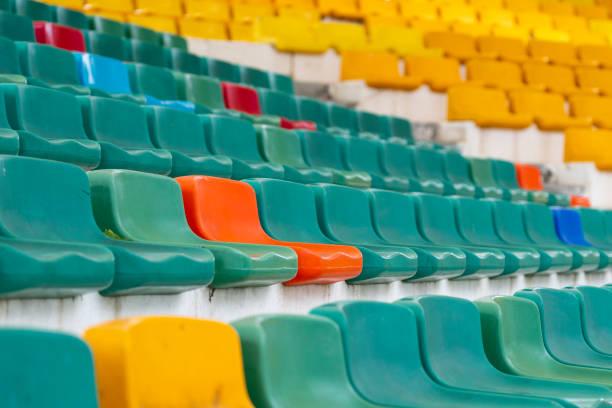 colored seats on a stadium stock photo