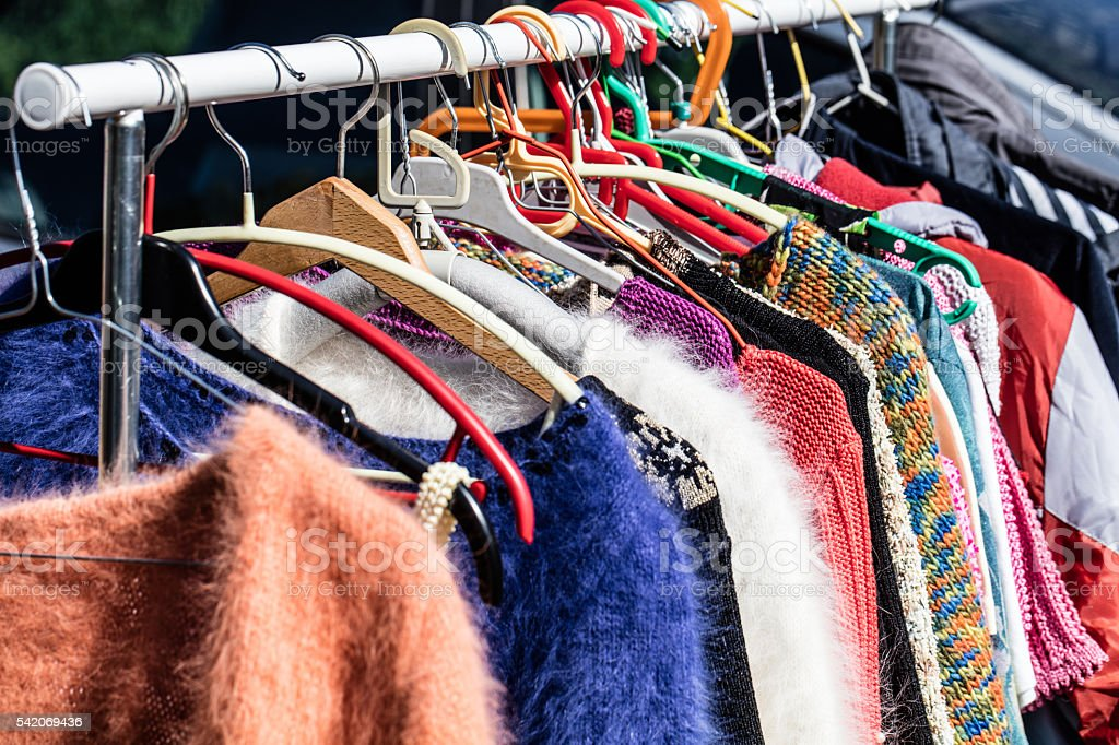 colored second hand women's sweaters at flea market​​​ foto