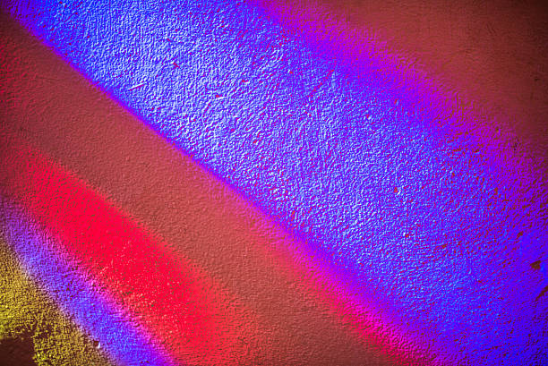 Colored shadow on wall from a stained glass window stock photo